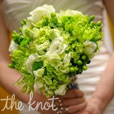green bouquet of lisianthus, spider poms and Kermit poms wrapped with rosary beads that had belonged to her grandmother