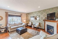 Family room is professional decorated with stone fireplace. Diamond Realty & Associates Ltd. Selling Real Estate, Home Buying, Open House, Family Room, This Is Us, Stone, Diamond, Beautiful, Home Decor