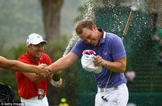 The Englishman is showered in champagne after claiming a four shot victory