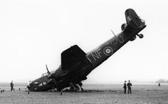 Handley Page Halifax B Mark II, W1007 'NF-U', of No. 138 (Special Duties) Squadron RAF, resting on its nose at Tempsford, Bedfordshire, having burst a tyre on landing and swung off the runway.