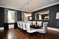 grey formal dining room with crystal chandelier