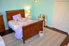 Painted little girl's bedroom Benjamin Moore Jamaican Aqua.  Worked great with Dash and Albert Neapolitan rug!