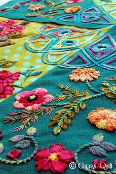 Bohemian Flowers II - 861 pins, BACK /francier/embroider/ -- notice string stems, orange flowers w/ texture. Red flower by stems ribbons.