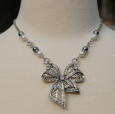 Silver Rhinestone Bow Assemblage Necklace - Repurposed Vintage Jewelry. $46.00, via Etsy.