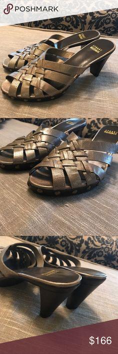 Stuart Weitzman Criss cross open toe heel Stuart Weitzman Criss cross open toe heel in a pewter shade with bronze rivets.   EUC Stuart Weitzman Shoes Heels