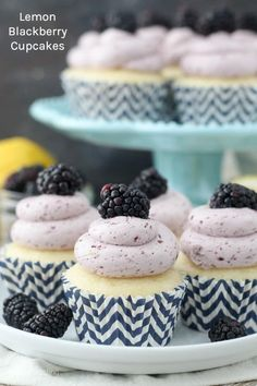 These Lemon Blackberry Cupcakes are moist homemade cupcakes bursting with lemon flavor. These cupcakes are topped with a fresh blackberry Swiss meringue buttercream. These Lemon Blackberry Cupcakes are perfect for summer, baby or wedding showers or any of your party needs. #cupcake #blackberry #blackberryfrosting #lemoncupcake #swissmeringuebuttercream #lemonblackberry #lemondessert
