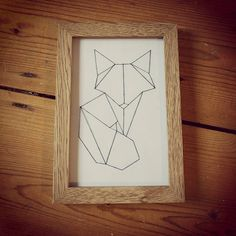 Handmade geometric fox artwork. 6 by 4 size, framed in light birch frame. Can be made using different coloured thread, please specify when ordering.