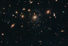 Hubble Sees Spiral Bridge of Young Stars Between Two Ancient Galaxies