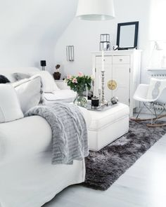 HOUSE of IDEAS  white, grey rug, eames, white interior, China cabinet