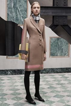 Perfect the smart casual look in a tan coat. Round off this look with black embellished suede pumps.   Shop this look on Lookastic: https://lookastic.com/women/looks/coat-pumps-clutch/23001   — White and Black Check Scarf  — Camel Coat  — Yellow Leather Clutch  — Black Tights  — Black Embellished Suede Pumps
