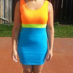 Selling this Neon Orange/Blue Sleeveless Club Dress in my Poshmark closet! My username is: conbon811. #shopmycloset #poshmark #fashion #shopping #style #forsale #Dresses & Skirts