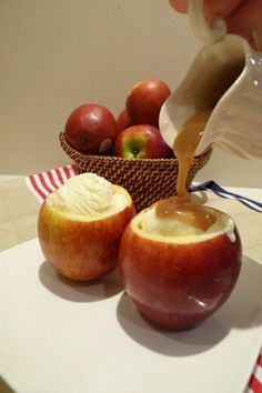 Hollow out apples. Mix together sugar and cinnamon and add to inside of apples.  Bake at 350 degrees F for 20 minutes. When apples are baked, fill with vanilla ice cream and top with caramel.