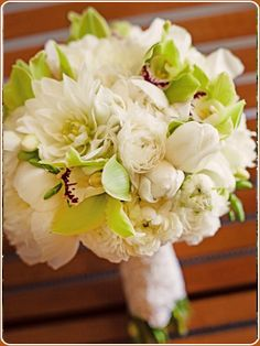 Instead of green orchids, we could have succulents with the dahlias and the ranunculus. It might be cheaper than peonies.