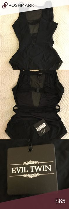 NWT ASOS black strappy one piece swim suit Selling brand new ASOS (evil twin) black one piece swimsuit black and strappy. Never ever worn still with tags. Size medium.    ASOS Black Strappy One Piece Swim Asos Swim One Pieces