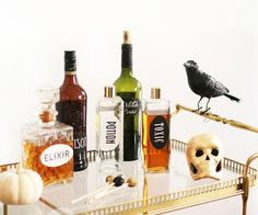 Pull out an assortment of glass decanters and bottles from the pantry, and spend the afternoon putting together a collection of eerie potions and elixirs fit for Halloween. Top it off with the addition of creepy decor.