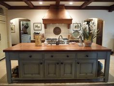 A French gray island and cabinets are features in an Alabama Stone Cottage kitchen. Blue Kitchen Island, Gray Island, Kitchen Islands, Cottage Kitchens, Home Kitchens, New Kitchen, Kitchen Dining, Kitchen Ideas, Kitchen Designs