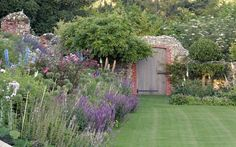 Herbaceous border in former tudor garden around an Elizabethan hall in Norfolk - Arne Maynard Garden Design
