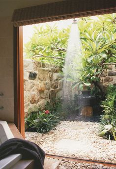 A private outdoor shower with a beautiful sandstone wall for privacy, to me, is an absolute luxury, and one well worth it's weight in your beach house. Imagine coming back from the beach, and stepping straight from the garden into the shower to wash away Outdoor Baths, Outdoor Bathrooms, Outdoor Rooms, Outdoor Gardens, Indoor Outdoor, Outdoor Living, Outdoor Kitchens, Outside Showers, Outdoor Showers