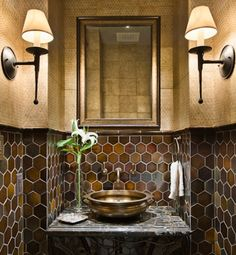 tiny bathrooms that are big on style...Jet Setter    Global style is achieved through a mix of dark hexagonal tiles and patterned wallpaper, while the vessel sink looks like it has been brought back from an exotic trip.