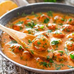 Skinny Thai Chicken Meatballs with Peanut Sauce - healthy baked chicken meatballs with Thai flavors in a sweet and spicy peanut sauce.