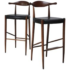 Pair of Danish Cow Horn Bar Stools in Teak and Leather after Hans Wegner | From a unique collection of antique and modern stools at https://www.1stdibs.com/furniture/seating/stools/