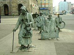 Anonymous Pedestrians. Wroclaw, Poland. 14 statues represent the people who disappeared during the introduction of Martial Law in 1981. Designed by Jerzy Kalina, there are seven statues on one side of the road crossing slowly disappearing underground whilst on the other side of the road another seven pedestrians emerge from the pavement.