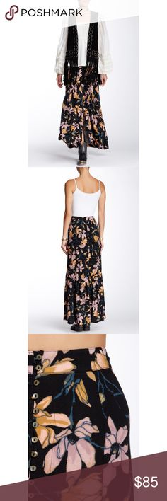 """Free People Floral Maxi Skirt Details - Side zip closure - Front partial button closure - Allover print - Front vent - Lined - Approx. 42"""" length - Imported Fiber Content Shell: 52% viscose, 48% rayon Lining: 100% rayon Care Hand wash cold Additional Info Fit: this style fits true to size.  Model's stats for sizing: - Height: 5'10"""" - Bust: 32"""" - Waist: 24"""" - Hips: 34"""" Model is wearing size 2. Free People Skirts Maxi"""