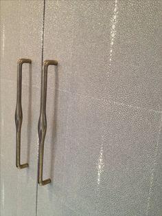 Glass bead shagreen wallpaper and Rocky Mountain door handles for the closet doors. Luxurious and feminine.