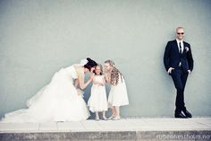 a photo of the bride close to the ringbarrier or the kids that are at the reception but also with the groom is really a beautiful idea