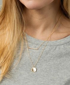 Simple gold bar necklace. Wear alone or layered with our disc necklace as shown. D E T A I L S: • Premium bar and disc pendants • Beautiful dainty chains • Each necklace has its own clasp • Hand-hammered bar measures 1 • Hand-hammered disc measures 1/2 • Lengths shown in the photo are 17 and
