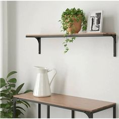 FJÄLLBO Wall shelf, black, 39 This rustic wall shelf is perfect if you want an industrial design feeling at home. Metal and solid wood create the robust look – and it also can be matched with the rest of the FJÄLLBO series. Wall Shelving Systems, Ikea Wall Shelves, Black Wall Shelves, Rustic Wall Shelves, Solid Wood Shelves, Rustic Walls, Floating Shelves, Shelf Wall, Floating Wall