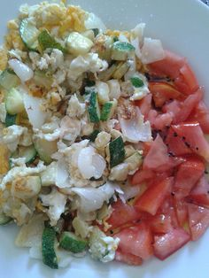 ... Scrambled eggs with zucchini and spring onions plus tomato salad with