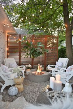 pretty outdoor seating area with string lights and fireplace