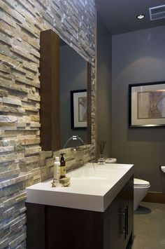 – Make a bold statement with a textured focal point in the bathroom. The juxtaposition of stone and glass never disappoints. When working with natural stone, keep your palette simple, grays and warm browns work best. Give it life by popping in brilliant whites. Check out the seamless integration of the faucet in the mirror.     -- contemporary bathroom design by vancouver kitchen and bath Old World Kitchens & Custom Cabinets Bad Inspiration, Bathroom Inspiration, Bathroom Ideas, Bathroom Wall, Basement Bathroom, Bathroom Storage, Wall Tile, Bathroom Organization, Bathroom Interior