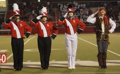 "Souderton Big Red Marching Band begins its 2013-14 season off by being awarded third place in Cavalcade's Liberty Division during a competition at Owen J. Roberts High School Oct. 5. This year's theme is ""Hoist the Colours: Music from Disney's Pirates of the Caribbean."" Pictured are, from left, Adam Giagnacova, Dreya Cherry, drum major Natalie Robertson  and color guard captain Jeff Bretz. Photo courtesy of Bill Schloo"