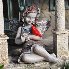 Fairy April is quite content to sit quietly in the fairy garden and smile at her newest friend, the crimson red bird. Dressed in a gray sundress with Celeste blue polka dots, she is sitting in a cross