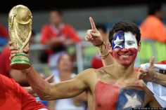 Chile's fans watch a Group B football match between Chile and Australia at the Pantanal Arena in Cuiaba during the 2014 FIFA World Cup on June 13, 2014. (MARTIN BERNETTI/AFP/Getty Images)