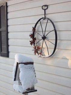 Old wheel as a wreath! Hay hook hanger! <3