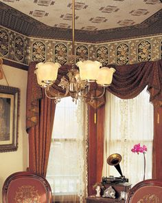 Victorian sitting room with paint/paper detailed ceiling and top of walls.