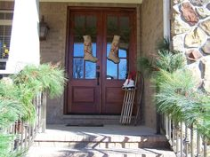 Slet and stockings instead of a wreath.  Exterior Christmas Front Door