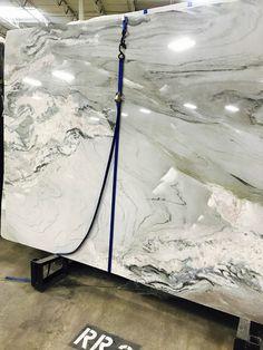 Granites, Quartz, Marble Oh My! Grey and Pink, and Tan quartz countertop