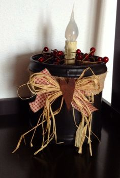 My diy primitive project for today. Love the way it turned out. Just made out of an old coffee can :)
