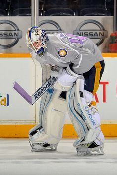 Goalie Magnus Hellberg of the Nashville Predators wears a #HockeyFightsCancer jersey during warm-ups.
