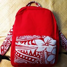 Check out www.pacificroots.com for the latest trends in Poly fashion. From snap backs, bucket hats, nail decals, shirts and varsity jackets to sunnies, back packs and much more. Follow them on Instagram @pacificrootsapparel - red back pack w/ Island patterns