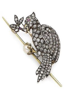 A ruby, pearl and diamond bird brooch, circa 1880 Designed as a parrot, the body set with rose, old brilliant-cut and cushion-shaped diamonds, reaching with open beak to a similarly-cut diamond insect, both with a circular cabochon ruby eye, and clutching a 5.6mm pearl, old brilliant-cut and cushion-shaped diamonds approx. 1.10cts total.