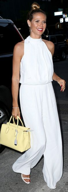 Heidi Klum wearing Alexis and MCM