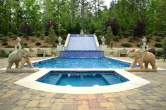 European Mansion – Luxurious Pool w elephant statues. sloped yard fountain.