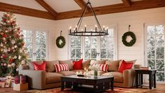 Pops of red, green, white and gold Christmas decor in the living room. The 12 light Pearson chandilier provides and beautiful center piece with the surrounding decorated christmas tree and holiday wreaths. #modernfarmhousechristmas #christmasdecorideasforthehome #farmhousechristmastree #christmasdecorideasfarmhouse #christmasdecorideas2019 #christmasdecorideasrustic #christmastreeideas #christmastreeideasfarmhouse #christmastreeideas2019