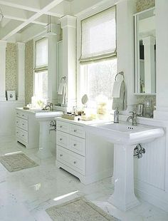 Pedestal Sinks and Freestanding Cabinetry. Rather than choosing a bulky double vanity, create a definitive look in your bathroom with pedestal sinks and freestanding cabinetry. In this bathroom, the cabinetry is placed beneath full-size windows that define the space. (Would prefer stained wood, but like the look overall.)