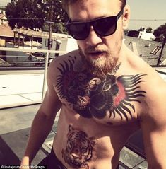 Conor McGregor reveals his new tattoo of a tiger on his stomach to his Instagram followers